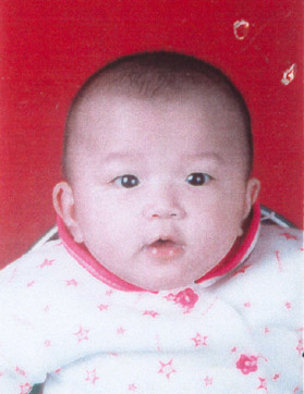 Claire, in China, month before her adoption