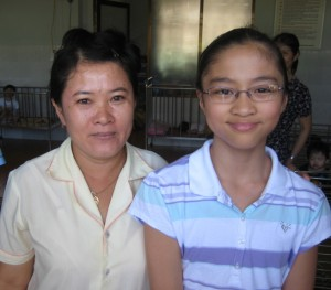 Marissa with the care giver from orphanage 11 years old